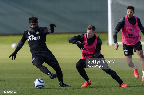 Allan Saint-Maximin controls the ball as Emil Krafth applies pressure and Joelinton is backup during the Newcastle United Training session at the...