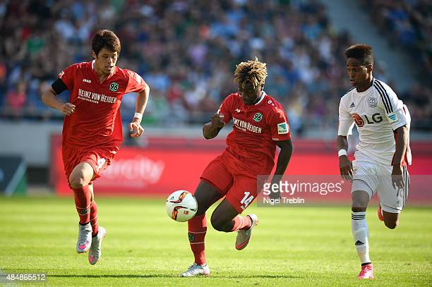 Allan SaintMaximin of Hannover and Hiroki Sakai of Hannover are challenged by Wendell of Leverkusen during the Bundesliga match between Hannover 96...