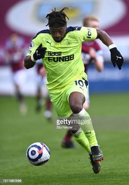 Allan Saint-Maximin of Newcastle on the ball during the Premier League match between Burnley and Newcastle United at Turf Moor on April 11, 2021 in...