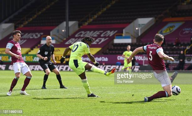 Allan Saint-Maximin of Newcastle shoots to score the winning goal during the Premier League match between Burnley and Newcastle United at Turf Moor...