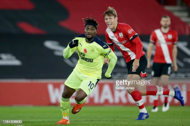 Allan Saint-Maximin of Newcastle United and Jannik Vestergaard of Southampton during the Premier League match between Southampton and Newcastle...