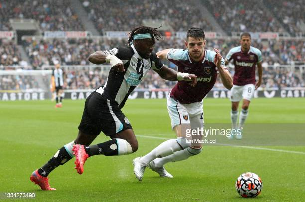 Allan Saint-Maximin of Newcastle United battles for possession with Declan Rice of West Ham United during the Premier League match between Newcastle...