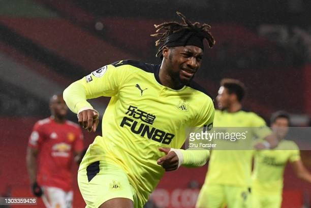 Allan Saint-Maximin of Newcastle United celebrates after scoring his team's first goal during the Premier League match between Manchester United and...