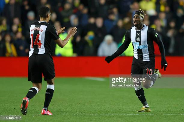 Allan Saint-Maximin of Newcastle United celebrates with Isaac Hayden after scoring his team's third goal during the FA Cup Fourth Round Replay match...