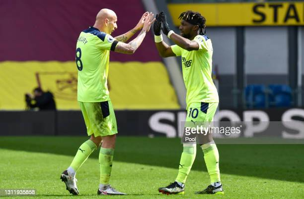 Allan Saint-Maximin of Newcastle United celebrates with Jonjo Shelvey after scoring their side's second goal during the Premier League match between...