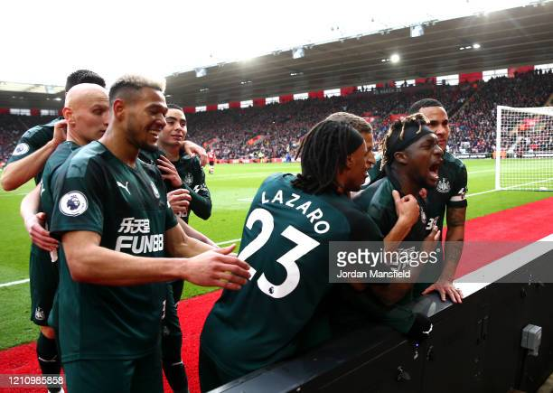 Allan SaintMaximin of Newcastle United celebrates with teammates after scoring his team's first goal during the Premier League match between...
