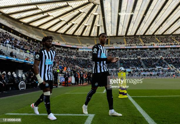 Allan Saint-Maximin of Newcastle United FC and Joe Willock walk out on to the pitch during the Premier League match between Newcastle United and...