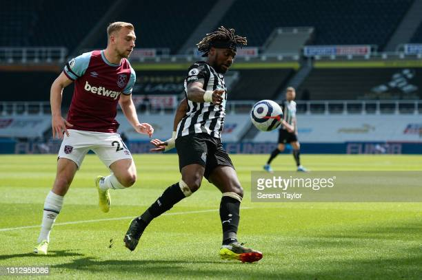 Allan Saint-Maximin of Newcastle United FC controls the ball as Jarrod Bowen of West Ham United applies pressure during the Premier League match...