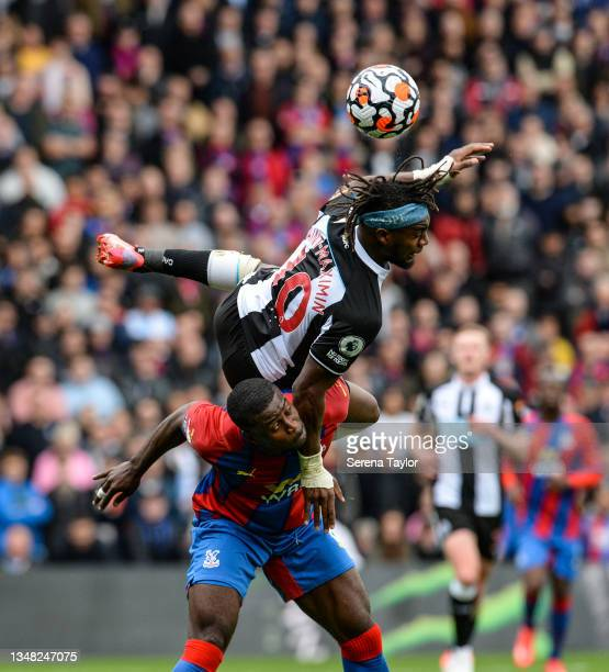Allan Saint-Maximin of Newcastle United FC dives over Marc Guehi of Crystal Palace during the Premier League match between Crystal Palace and...