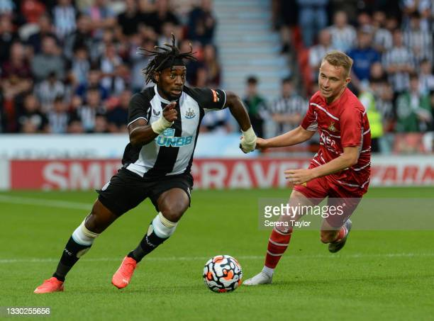 Allan Saint-Maximin of Newcastle United FC dribbles past a Doncaster Rovers Trialist during the Pre Season Friendly between Doncaster Rovers and...