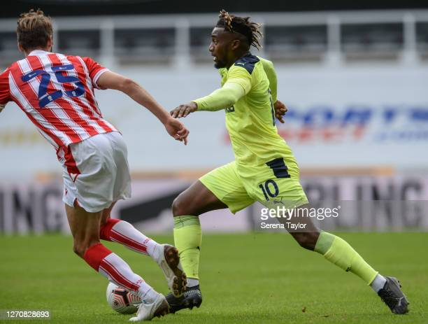Allan SaintMaximin of Newcastle United FC runs with the ball as Nick Powell of Stoke City defends during the Pre Season Friendly between Newcastle...