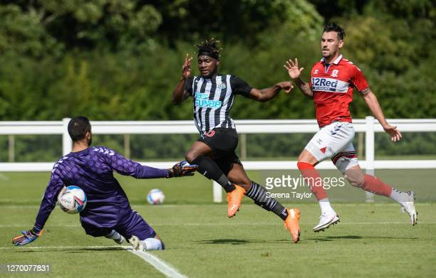 Allan SaintMaximin of Newcastle United FC scores past Middlesbrough Goalkeeper Dejan Stojanović during the Pre Season Friendly between Newcastle...
