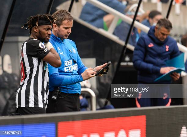 Allan Saint-Maximin of Newcastle United FC speaks to Newcastle United First Team Coach Stephen Clemence during the Premier League match between...