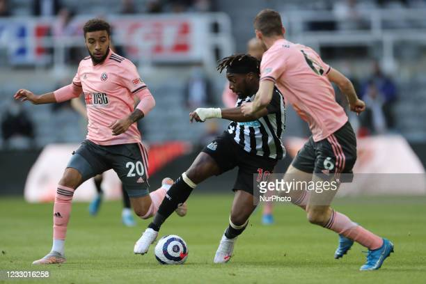 Allan Saint-Maximin of Newcastle United in action with Sheffield United's Chris Basham and Jayden Bogle during the Premier League match between...
