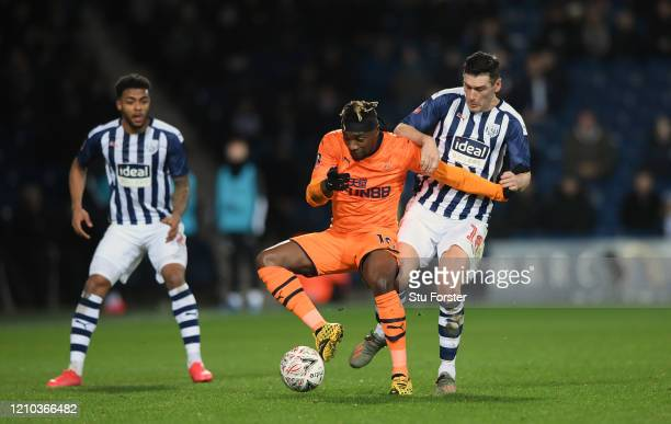 Allan SaintMaximin of Newcastle United is challenged by WBA player Gareth Barry during the FA Cup Fifth Round match between West Bromwich Albion and...