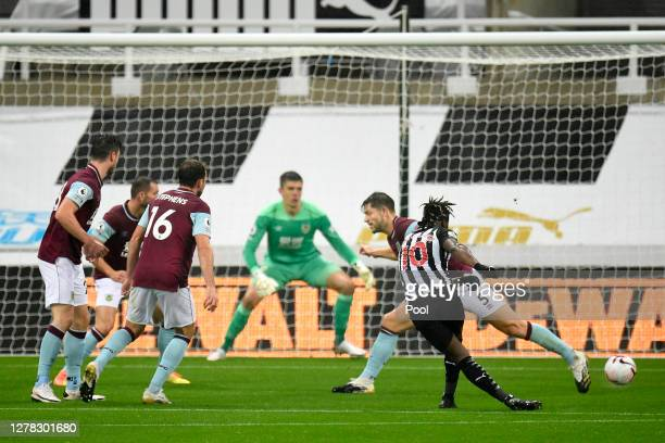 Allan Saint-Maximin of Newcastle United scores his team's first goal during the Premier League match between Newcastle United and Burnley at St....