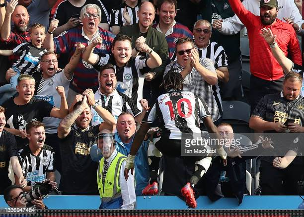 Allan Saint-Maximin of Newcastle United scores his teams second goal during the Premier League match between Newcastle United and Southampton at St....