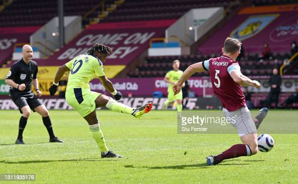 Allan Saint-Maximin of Newcastle United scores their team's second goal past James Tarkowski of Burnley during the Premier League match between...