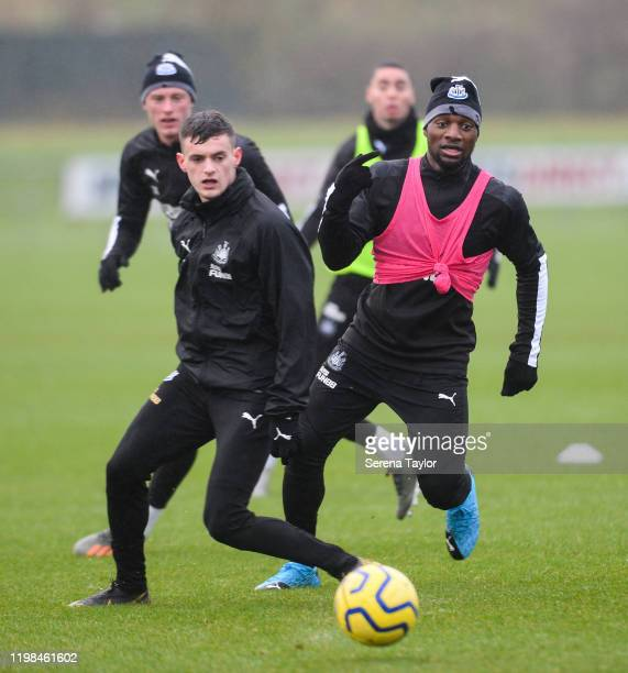 Allan SaintMaximin passes the ball past defending Tom Allan during the Newcastle United Training Session at the Newcastle United Training Centre on...