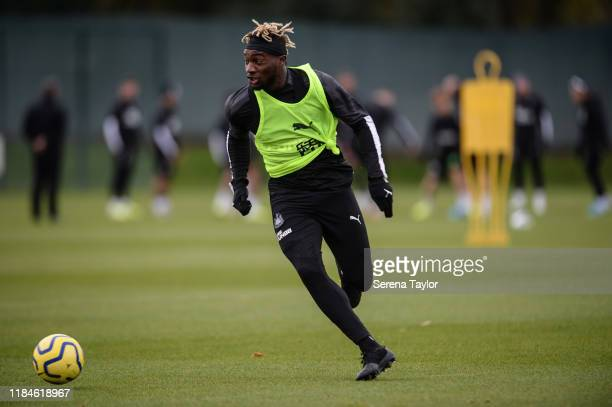Allan Saint-Maximin runs with the ball during the Newcastle United Training Session at the Newcastle United Training Centre on October 31, 2019 in...