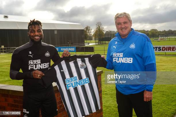 Allan Saint-Mazimin poses for photographs after signing a new six year contract at the Newcastle United Training Centre on October 14, 2020 in...