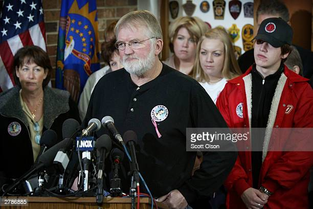 Allan Sjodin father of missing college student Dru Sjodin addresses the media flanked by family and friends in Grand Forks North Dakota December 5...