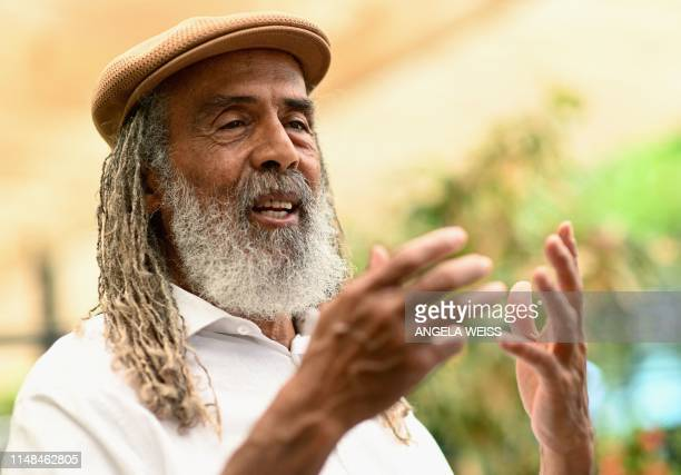 Allan Skill Cole Jamaican former footballer and tour manager of Bob Marley and The Wailers speaks during an interviewed in Kingston Jamaica on May 17...