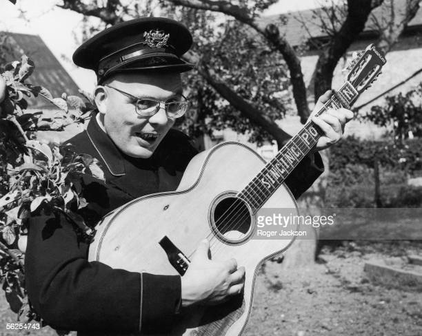 Allan Smethurst aka The Singing Postman can't keep his hands off his guitar near his home town of Sheringham Norfolk 8th September 1966