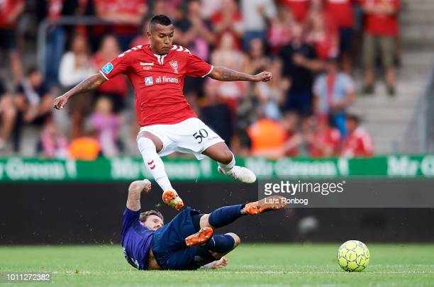 Allan Sousa of Vejle Boldklub and Kian Hansen of FC Midtjylland compete for the ball during the Danish Superliga match between Vejle Boldklub and FC...