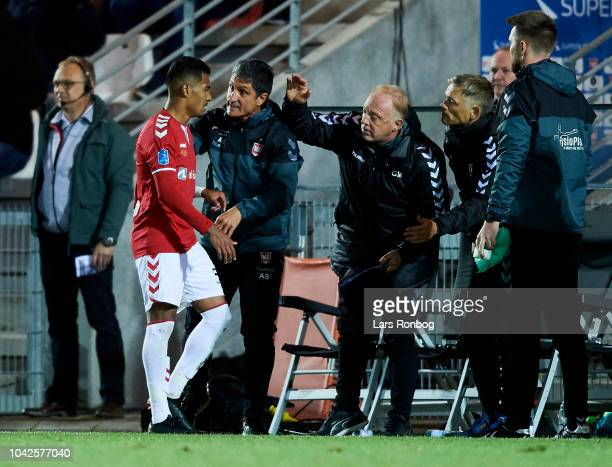 Allan Sousa of Vejle Boldklub leaving the pitch and speaks to Adolfo Sormani head coach of Vejle Boldklub during the Danish Superliga match between...