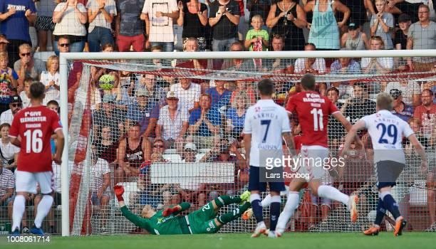 Allan Sousa of Vejle Boldklub scores the 11 goal on a penalty kick against Goalkeeper Aleksandar Jovanovic of AGF Aarhus during the Danish Superliga...