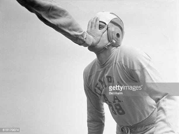Allan Sturges, of Delanson, NY, who was first string tackle in 1936, finds out he has sort of forgotten how to bring down a runner during the first...
