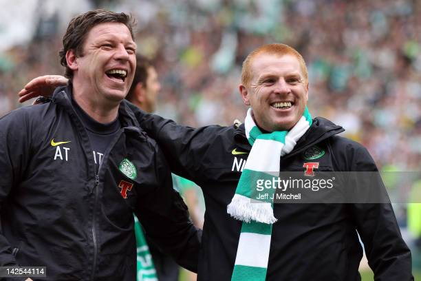 Allan Thompson and Coach Neil Lennon of Celtic celebrate following his team clinching the Scottish Clydesdale Bank Scottish Premier League title...