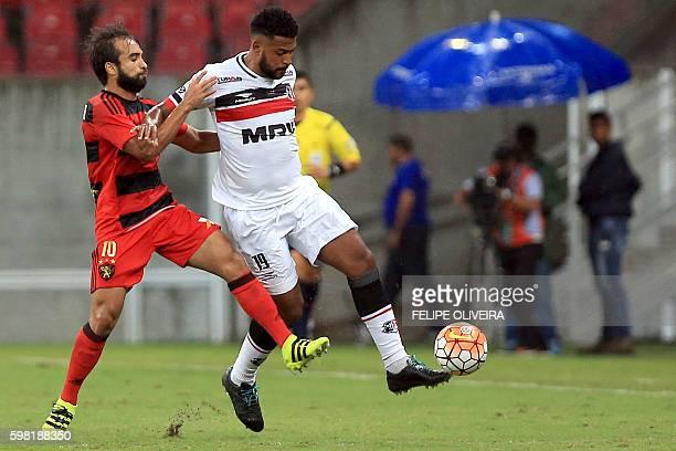 Allan Vieira of Brazilian Santa Cruz vies for the ball with Gabriel Xavier of Brazilian Sport Recife during a Sudamericana Cup football match in...
