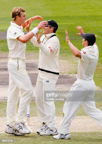Allan Wise David Hussey and Michael Klinger of the Bushrangers celebrate a wicket during day three of the Pura Cup match between the Victorian...
