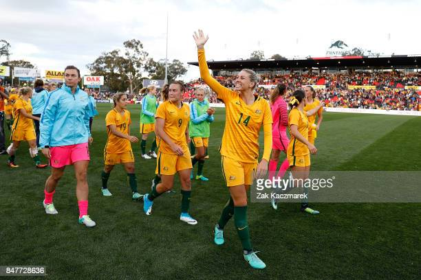 Allana Kennedy of Australia celebrates with team mates after victory over Brazil during the women's international match between the Australian...