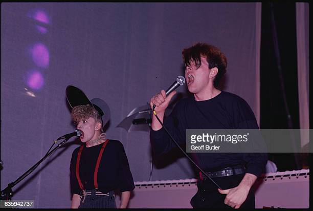 Allanah Currie and Tom Bailey of the Thompson Twins sing in concert