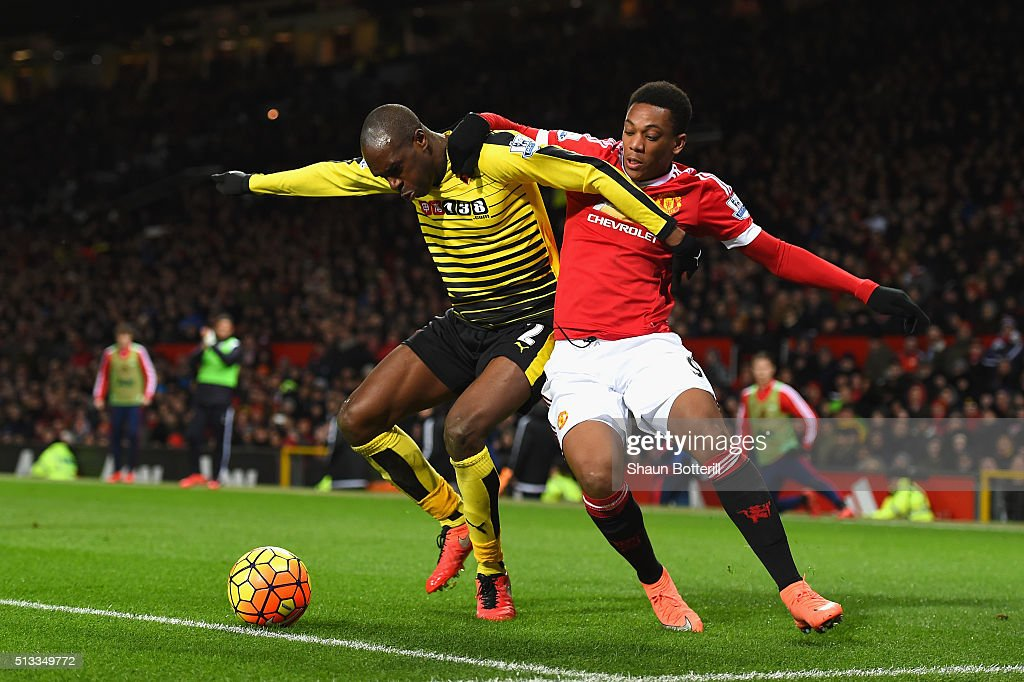 Allan-Romeo Nyom of Watford and Anthony Martial of Manchester United battle for the ball during the Barclays Premier League match between Manchester United and Watford at Old Trafford on March 2, 2016 in Manchester, England.