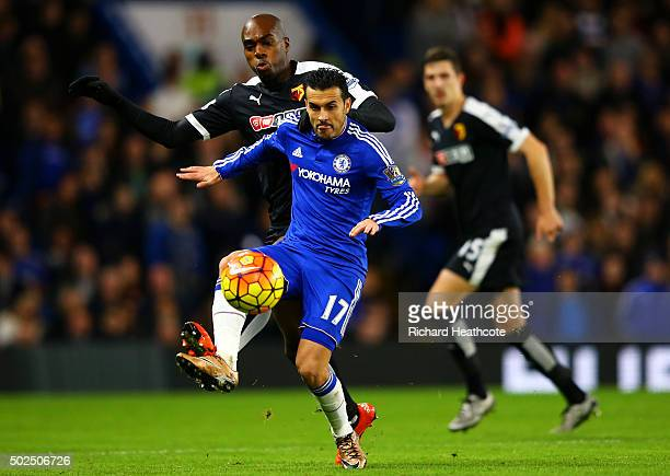 AllanRomeo Nyom of Watford battles for the ball with Pedro of Chelsea during the Barclays Premier League match between Chelsea and Watford at...