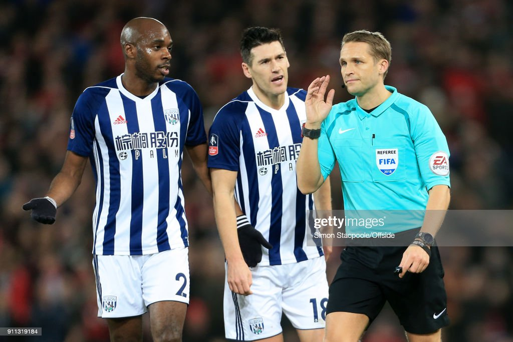Allan-Romeo Nyom of West Brom (L) and Gareth Barry of West Brom react after referee Craig Pawson awarded a penalty following a decision to refer to the Video Assistant Referee (VAR) system during The Emirates FA Cup Fourth Round match between Liverpool and West Bromwich Albion at Anfield on January 27, 2018 in Liverpool, England.