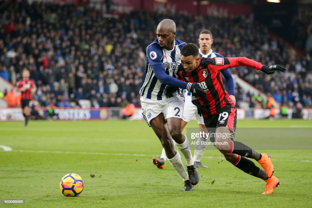 Allan-Romeo Nyom of West Bromwich Albion holds off Junior Stanislas of Bournemouth during the Premier League match between AFC Bournemouth and West Bromwich Albion at Vitality Stadium on March 17, 2018 in Bournemouth, England.