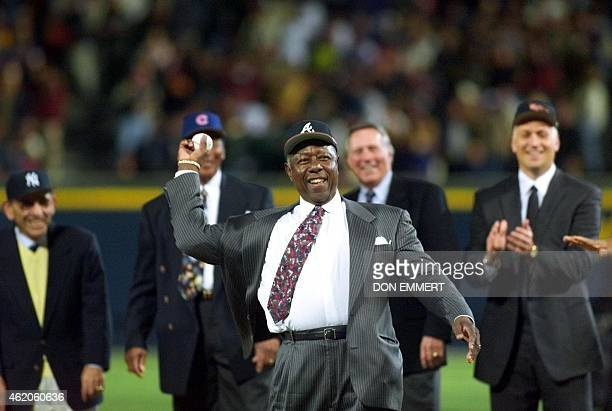 AllCentury team member Atlanta Braves great Henry Aaron is surrounded by other members of the team as he throws out the first pitch 24 October before...