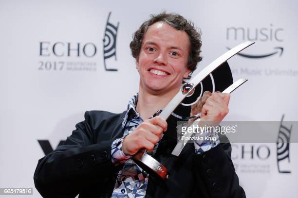 Alle Farben poses with his award at the Echo award winners board on April 6 2017 in Berlin Germany