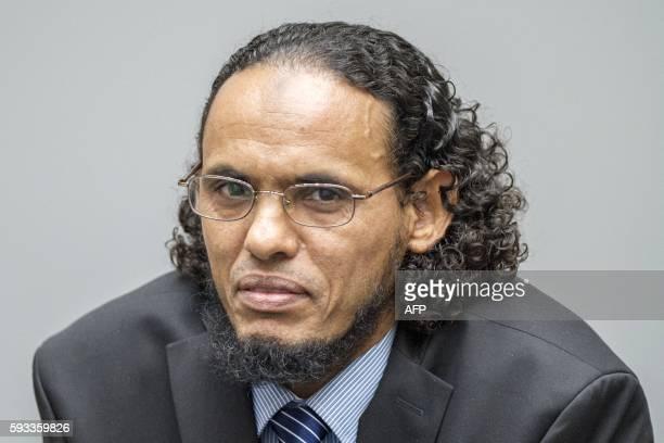 Alleged AlQaedalinked Islamist leader Ahmad Al Faqi Al Mahdi looks on during an appearance at the International Criminal Court in The Hague on August...
