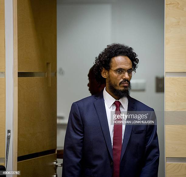 Alleged AlQaedalinked Islamist leader Ahmad Faqi Al Mahdi arrives in the courtroom of the International Criminal Court on September 30 in The Hague...