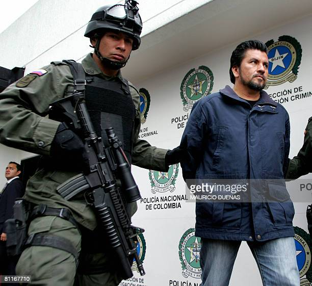 Alleged drug trafficker Gildardo Rodriguez Herrera aka The Man of the Red Shirt is escorted by the Colombian police to a press conference in Bogota...