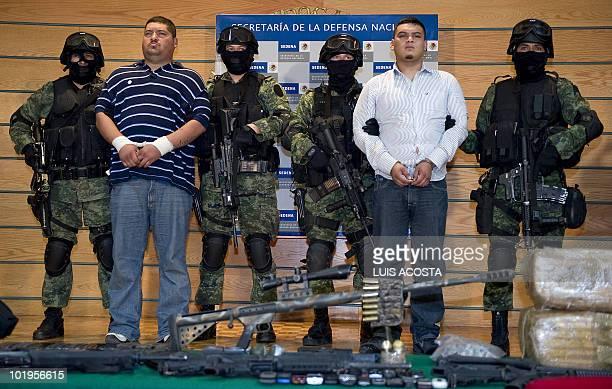 Alleged drug traffickers of the gang Los Zetas Hector Raul Luna aka el tori and David Eduardo Fuentes aka el chile are presented to the press in...