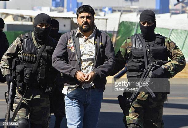 Alleged drugdealer Alfredo Beltran Leyva is showed to the media by members of the Mexican Army in Mexico City on January 21st after being captured in...