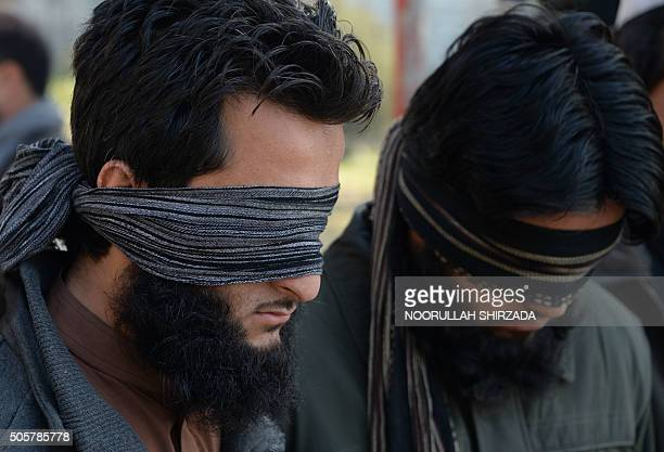 Alleged fighters for Islamic State stand handcuffed while being presented to the media at a police headquarter in Jalalabad Nangarhar province on...