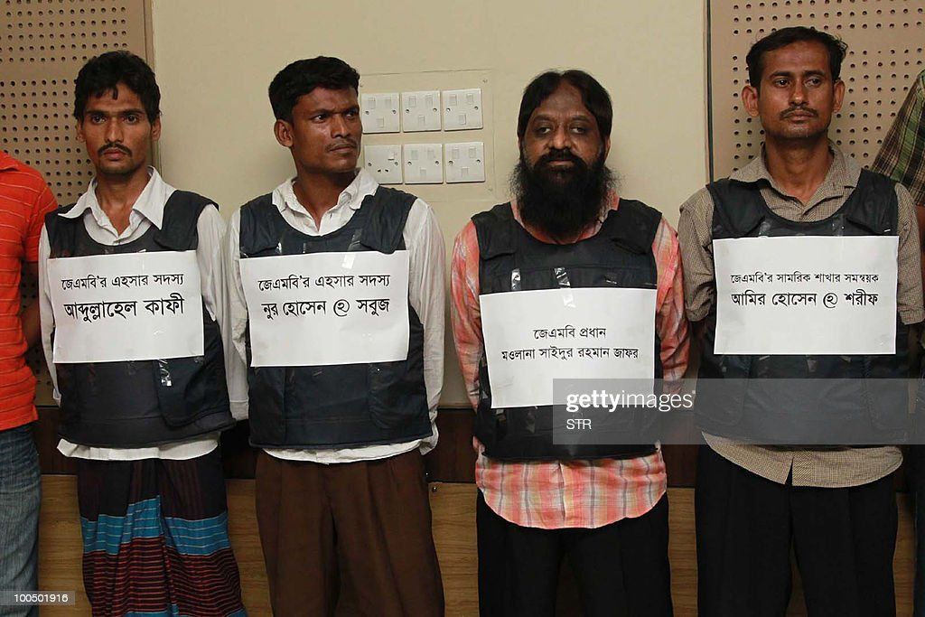 Alleged Islamic militants including Maolana Saidur Rahman (2R) pose for media representatives in Dhaka on May 25, 2010, after their arrest by authorities. Bangladeshi authorities have arrested the country's most wanted Islamic militant after a three-year manhunt, a spokesman for the security forces said. The militant, Maolana Saidur Rahman, is believed to taken over as the head of Jamayetul Mujahideen Bangladesh (JMB) after its leader and five key lieutenants were executed in March 2007, police said.